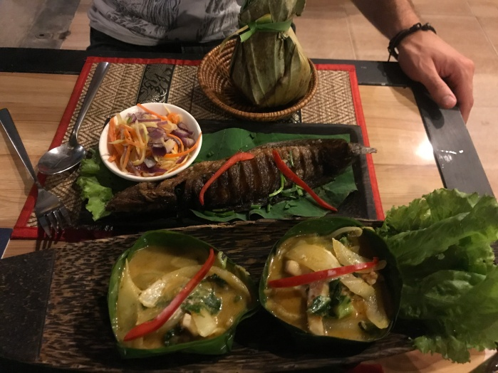 Whole deep fried catfish and fish amok served in banana leaves.
