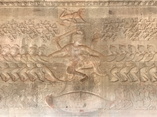 Bas-relief carving depicting what seems to be a tug of war. Hindu mythology suggests it's actually depicting the story of the churning of the Ocean of Milk, a struggle between demons and gods.